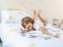 Debbie the Dog Organic Kids Bedding featuring a kid giving a thumbs up