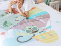 Jeanette the Cat Organic Kids Bedding featuring a closeup of boy reading book
